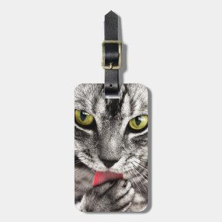 Grey Tabby cat licking paw Bag Tag