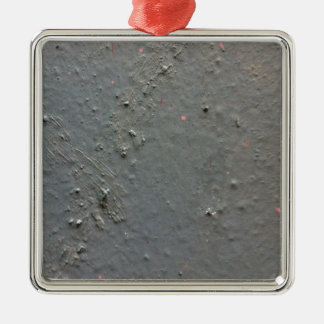 Grey textured rugged surface with concete effect metal ornament