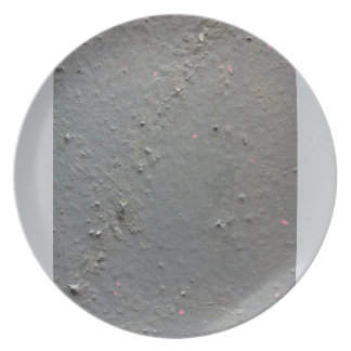 Grey textured rugged surface with concete effect dinner plates