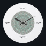 "Grey &amp; Turquoise Mandala &quot;Now&quot; Large Clock<br><div class=""desc"">Is it time to refresh your home? This round wall clock by Janusian Gallery features an intricately-detailed turquoise and grey mandala. Keep track of your meditation practice. It also makes a thoughtful housewarming gift. Instead of numbers, it has the word &quot;now&quot; at the 12, 3, 6, and 9 o&#39;clock positions....</div>"