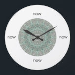 """Grey &amp; Turquoise Mandala &quot;Now&quot; Large Clock<br><div class=""""desc"""">Is it time to refresh your home? This round wall clock by Janusian Gallery features an intricately-detailed turquoise and grey mandala. Keep track of your meditation practice. It also makes a thoughtful housewarming gift. Instead of numbers, it has the word &quot;now&quot; at the 12, 3, 6, and 9 o&#39;clock positions....</div>"""