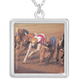 Greyhounds racing on track silver plated necklace