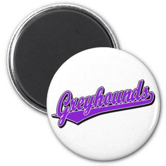 Greyhounds script logo in purple 2 inch round magnet