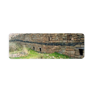 greywhackle aztec wall with windows and grassy are label