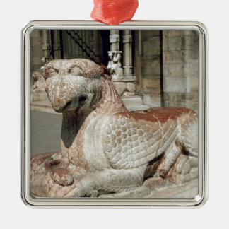 Griffin lying on a plinth, mid 13th century metal ornament