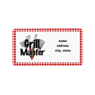 Grill Master con las herramientas y la mesa de pic Etiqueta De Dirección
