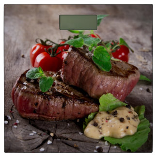 Grilled bbq steaks with fresh herbs and tomatoes bathroom scale