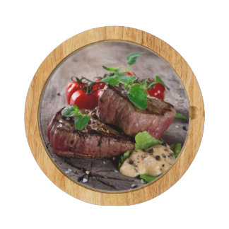 Grilled bbq steaks with fresh herbs and tomatoes cheese board