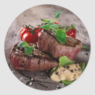 Grilled bbq steaks with fresh herbs and tomatoes classic round sticker