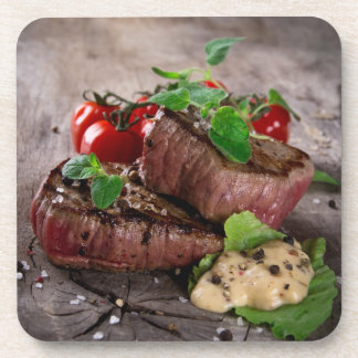 Grilled bbq steaks with fresh herbs and tomatoes coaster