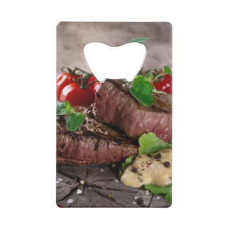 Grilled bbq steaks with fresh herbs and tomatoes credit card bottle opener