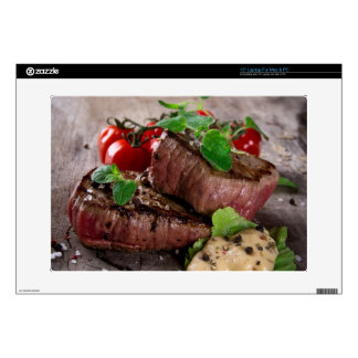 Grilled bbq steaks with fresh herbs and tomatoes decal for laptop