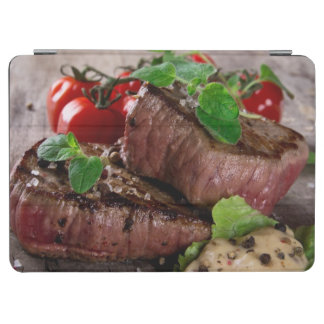 Grilled bbq steaks with fresh herbs and tomatoes iPad air cover