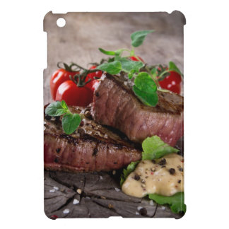 Grilled bbq steaks with fresh herbs and tomatoes iPad mini cover