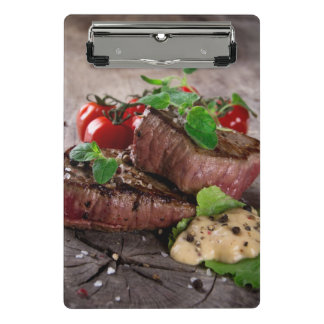 Grilled bbq steaks with fresh herbs and tomatoes mini clipboard