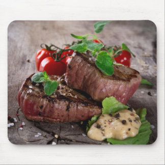 Grilled bbq steaks with fresh herbs and tomatoes mouse pad