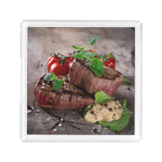 Grilled bbq steaks with fresh herbs and tomatoes serving tray