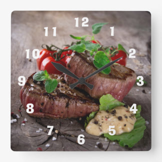 Grilled bbq steaks with fresh herbs and tomatoes square wall clock