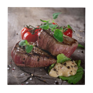 Grilled bbq steaks with fresh herbs and tomatoes tile