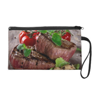 Grilled bbq steaks with fresh herbs and tomatoes wristlet purse
