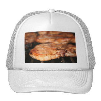 Grilled pork chops on the bbq close up photo trucker hat