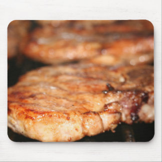 Grilled pork chops on the bbq close up photo mouse pad
