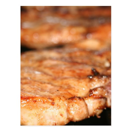 Grilled pork chops on the bbq close up photo postcards