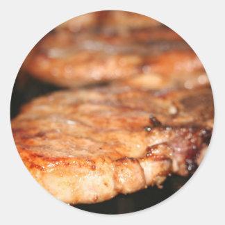 Grilled pork chops on the bbq close up photo round sticker