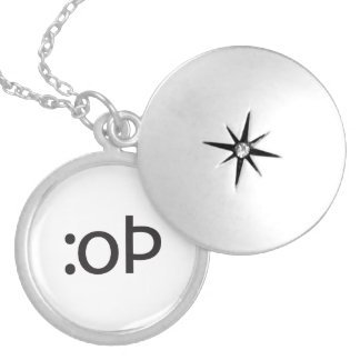 grinning tongue.ai round locket necklace