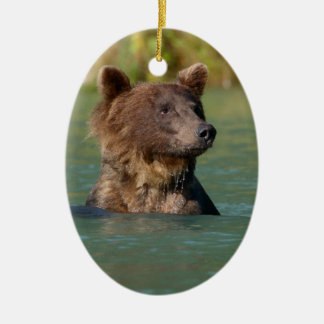 grizzly bear swimming ceramic ornament