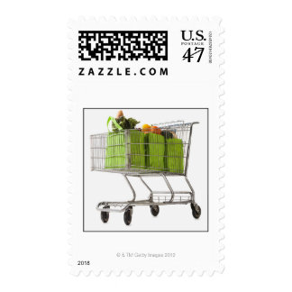 Grocery cart full of bagged produce postage