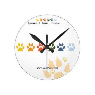 Groomer del mascota y animal del cuidado relojes