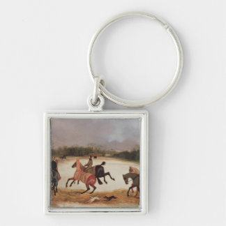 Grooms exercising racehorses keychain