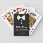 """Groomsman Playing Cards Wedding Gift<br><div class=""""desc"""">This fun deck of playing cards is designed as a gift for wedding groomsmen. The backs are black with a white bow tie and buttons. The text is white and reads """"Groomsman"""" with a place for his name, the name of the couple and the wedding date. Great gift to thank...</div>"""