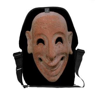 Grotesque mask, from Motya, 6th century BC (terrac Courier Bag