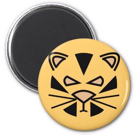 grouching tiger. 2 inch round magnet