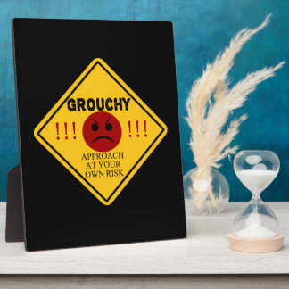 Grouchy. Approach at your own risk. Plaque