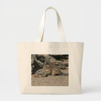 Ground squirrel with walnut canvas bags