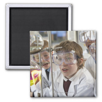 Group of children (9-12) watching experiment in magnet
