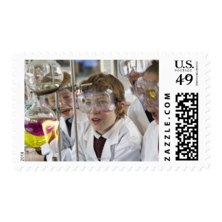 Group of children (9-12) watching experiment in postage