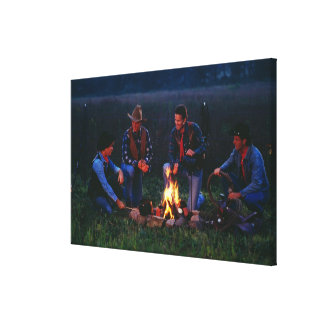 Group of cowboys around campfire canvas print