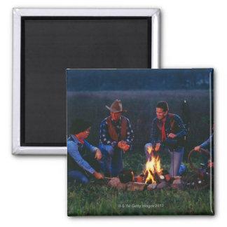 Group of cowboys around campfire refrigerator magnet