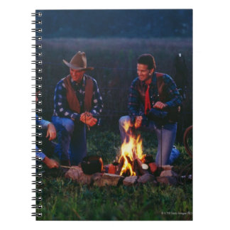 Group of cowboys around campfire notebook