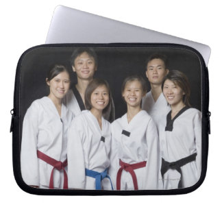 Group of martial arts player standing and laptop computer sleeves