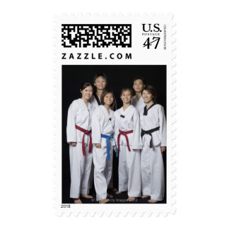 Group of martial arts player standing and postage