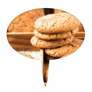Group of oatmeal cookies on the wooden tray cake topper