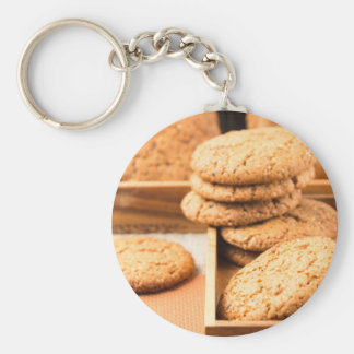 Group of oatmeal cookies on the wooden tray keychain