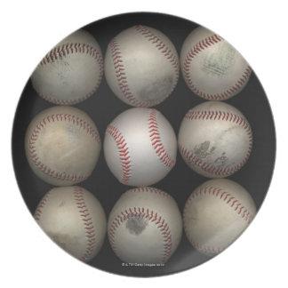 Group of old baseballs on black background melamine plate