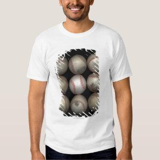 Group of old baseballs on black background t-shirt