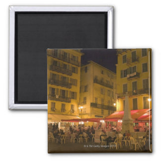 Group of people sitting at a sidewalk cafe, 2 inch square magnet
